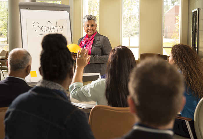 Woman leads an office Quick Take on Safety training about workplace safety