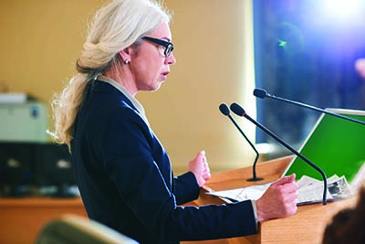 Mature woman speaks at board meeting